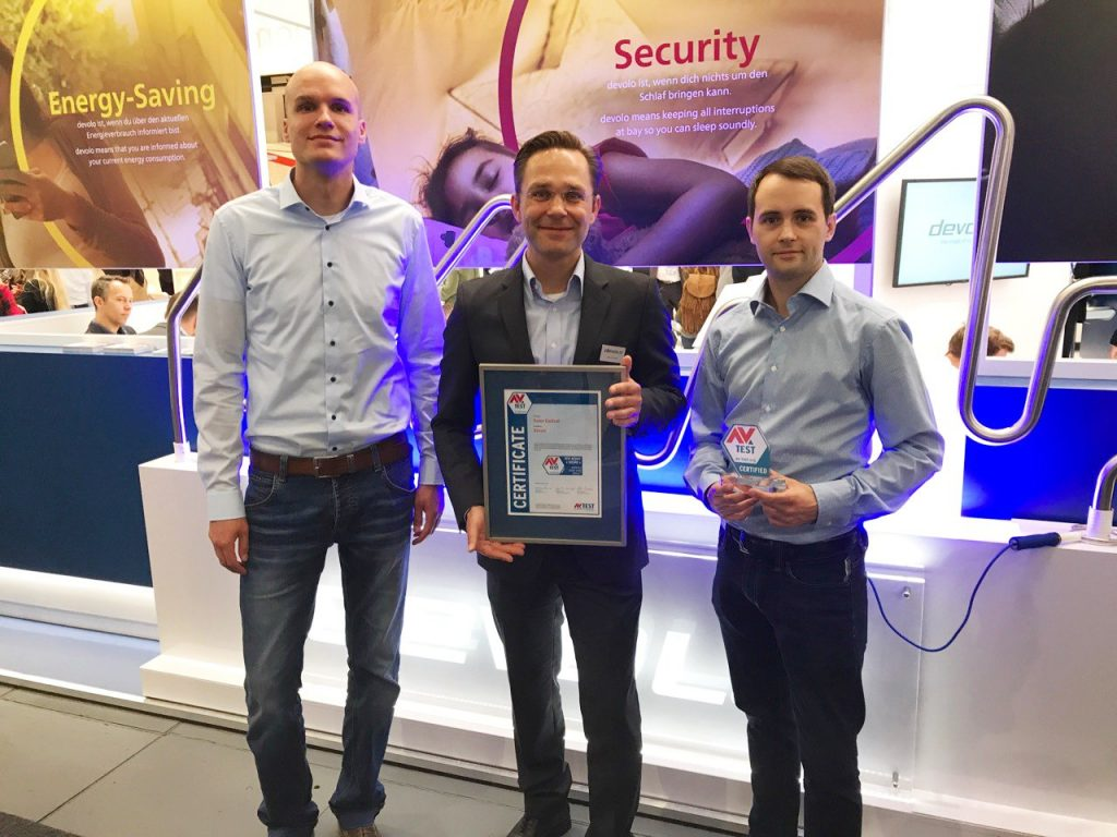 AV-TESTs CTO Maik Morgenstern and IoT Security Expert Eric Clausing awarding Devolo Home Control. Marcel Schüll, PR Manager at Devolo, gets the certificate.