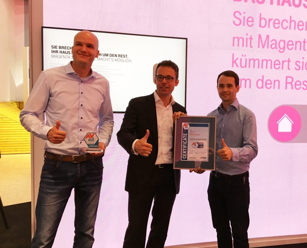 Carsten Steigleder, Senior Manager Smart Home at Deutsche Telekom, receives the certificate for the QIVICON Smart Home platform.
