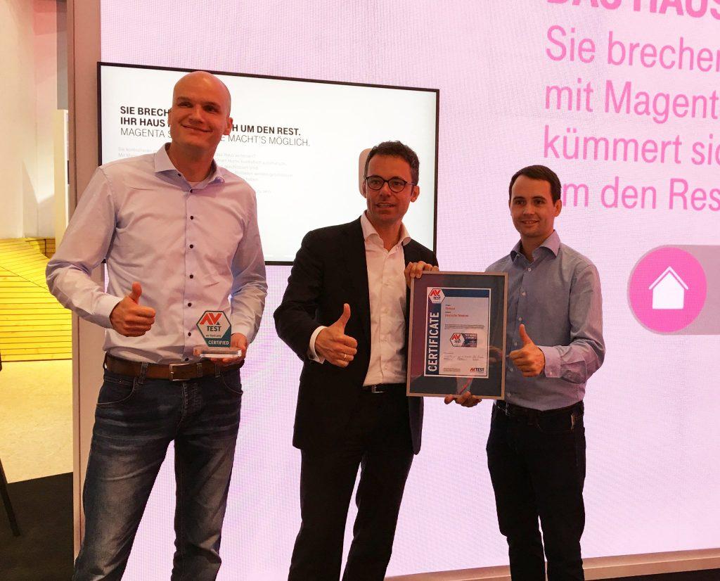 Carsten Steigleder, Senior Manager Smart Home at Deutsche Telekom, receives the certificate for the QIVICON Smart Home platform.